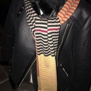 Multi- colored stripe scarf. Beige red black more